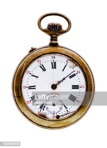 An old gold pocket watch on a white background