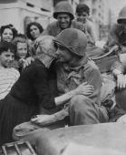 An old Italian woman shows her gratitude to one of the American soldiers following the liberation of Italy