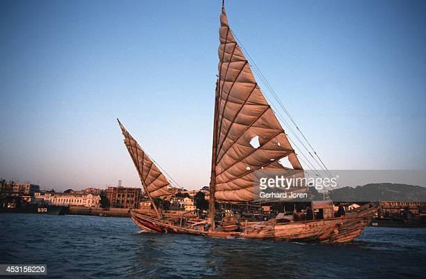 An old junk sails outside Xiamen in Fujian province