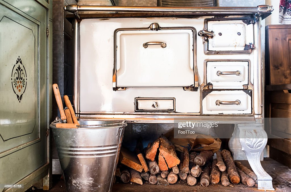 An Old Kitchen With A Pile Of Firewood : Stock Photo
