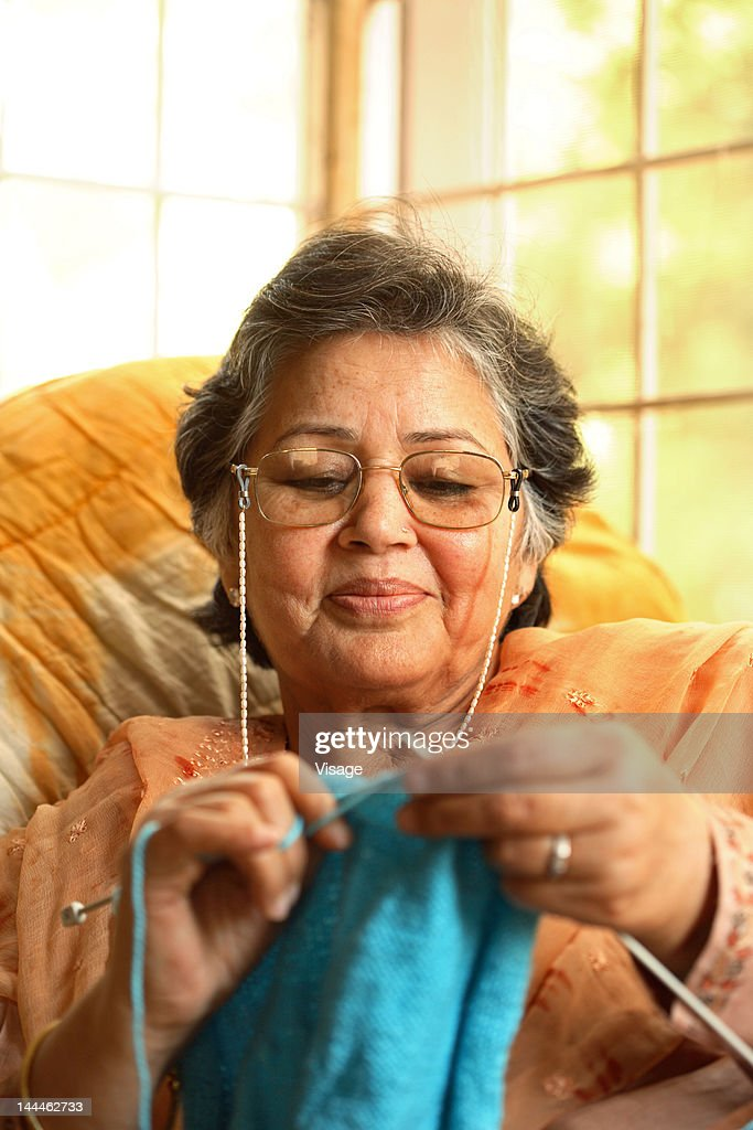 Old Lady Knitting Images : An old lady knitting stock photo getty images