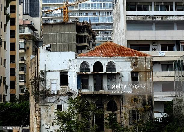 An old Lebanese house stands among the modern buildings and a construction site on Beirut's Corniche on October 7 2015 Lebanon is buzzing with...