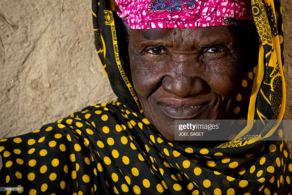 An old Malian woman is seen on February 28, 2013 on a street in Gao. AFP PHOTO /JOEL SAGET