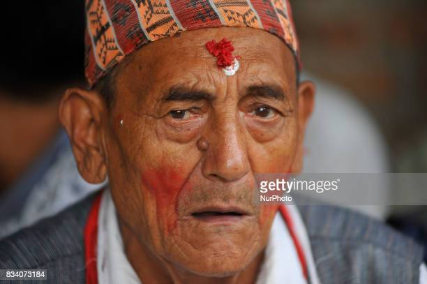 An old man chants tradition songs during celebration of Bagh Bhairab festival celebrated at Kirtipur Kathmandu Nepal on Thursday August 17 2017 On...