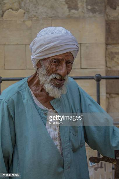 An old man crossed the 65yearold Grilled potato vendor working in a hot Darb El Ahmar in Cairo on 3rd October 2015