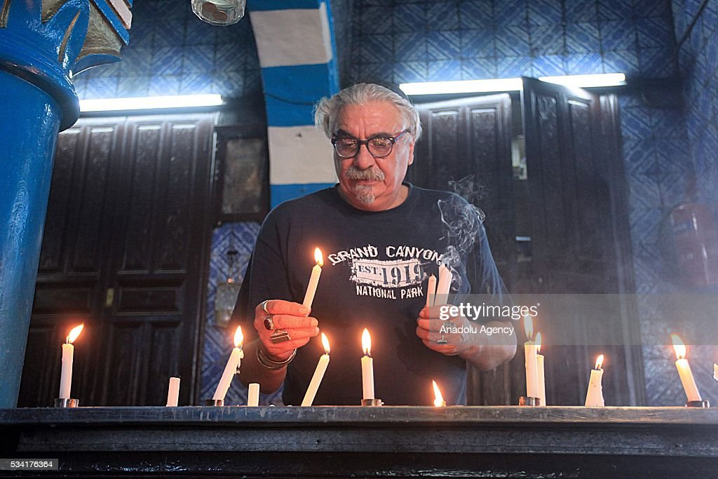 An old man lights candles as Jews from different countries visit Synagogue La ghriba to celebrate Lag BaOmer in Djerba, Tunisia on May 25, 2016.