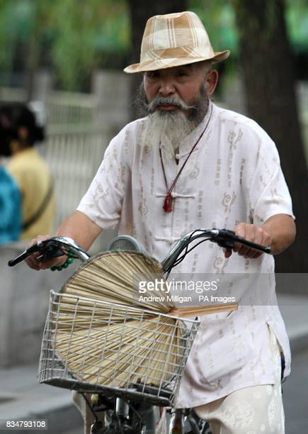 An old man rides through the streets of Beijing China on his bicycle