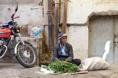 An old man sells watercress in the bazaar of the Kurdish city of Sulaimaniyah On June 10th ISIS fighters took control of the Iraqi city of Mosul...