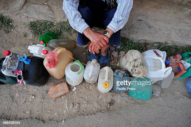 An old man stays in a queue for Kerosene from early morningFor the past few months neighboring India has blocked the transportation of fuel and daily...