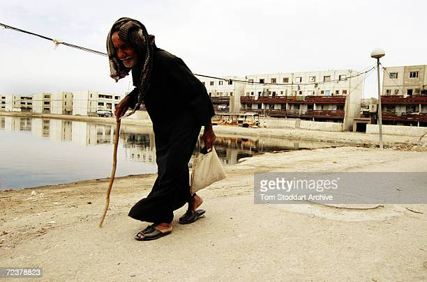 An old man walks home from the market in the southern city of Basra in Iraq