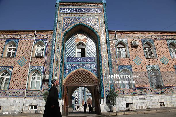 An old man walks in front of the entrance to the Haji Yakoub Mosque in Dushanbe the main Islamic landmark in the city seen on June 11 2015 Tajikistan...