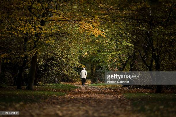 An old man walks through the colorful park 'Messelpark' on October 29 2016 in Berlin Germany