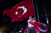An old man waves a Turkish national flag during a protest against Parallel State/Gulenist Terrorist Organization's failed military coup attempt at...