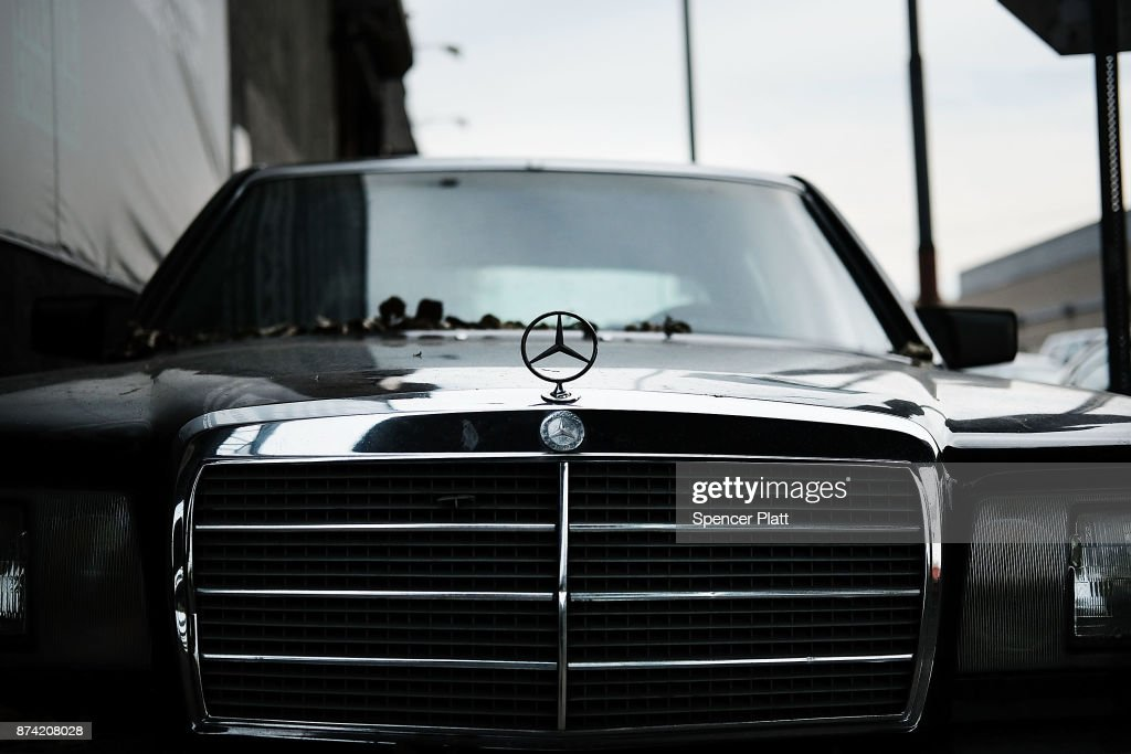 An old Mercedes sits in front of a mechanic's shop on November 14, 2017 in New York City. According to a new report by the International Energy Agency, (IEA) global oil demand will fall only slightly alongside the predicted rise in electric vehicles over the next two decades. In its World Energy Outlook 2018, the Paris-based group expects oil prices should continue to rise towards $83 a barrel by the mid-2020s and that the U.S. will be a dominant force in global oil and gas markets for many years to come. The IEA report also predicts that the world will use just over 100 million barrels of oil a day by 2025.