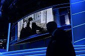 An old photo of Republican presidential candidate Donald Trump with his father appears on a giant screen on the last day of the Republican National...