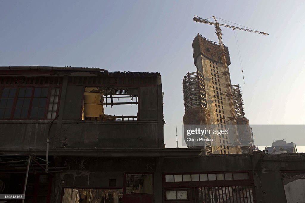 An old residential building being demolished and new building being built are seen at the North Bund on February 19, 2012 in Shanghai, China. According to local media, the North Bund area will be reconstructed as a international shipping and financial zone, a modern commercial and high-end residential area, and recreation center.