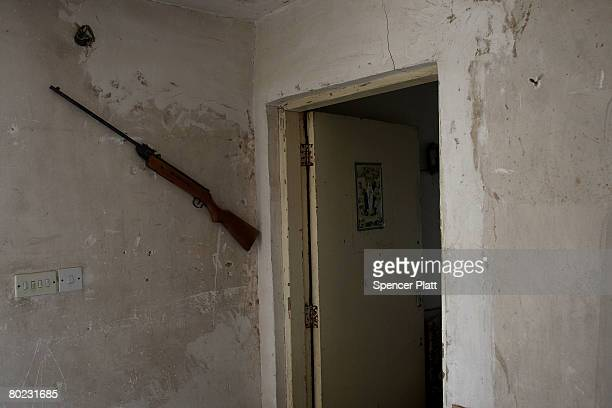 An old rifle hangs on a bedroom wall in a home in a neighborhood that has been heavily afflicted by fighting March 12 2008 in Baghdad Iraq Interior...