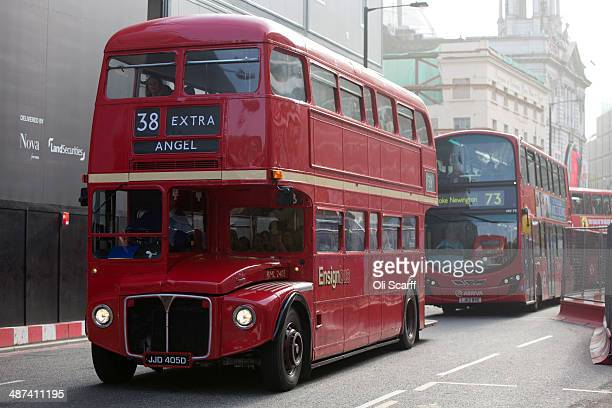 An old Routemaster doubledecker bus which had been decommissioned from regular service carries commuters from Victoria Station whilst the London...