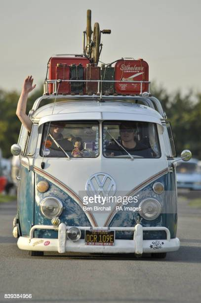 An old school BMX and various antique petrol cans and cool boxes sit on the roof rack of a VW Splitscreen Type 2 Transporter at Vanfest festival in...
