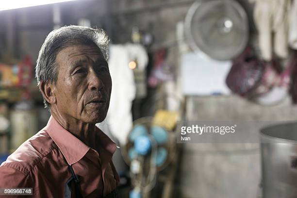An Old Senior Asian Man Looking Right