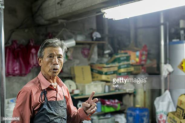 An Old Senior Asian Man Talking with Confidence