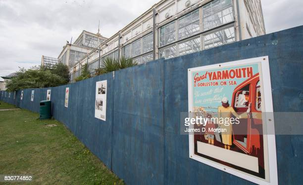 An old sign advertising holidays hangs on a board next to the winter Gardens on August 12 2017 in Great Yarmouth England A cloudy overcast day...