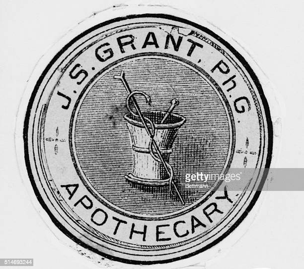 An old sign for JS Grant's Apothecary a drugstore