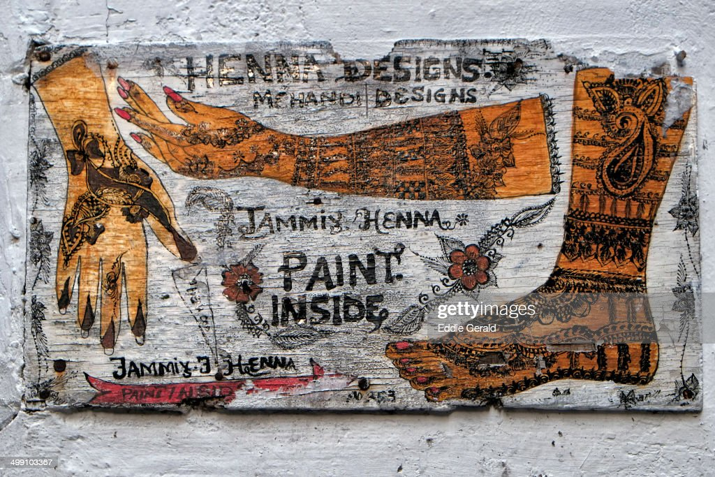 CONTENT] An old sign of Henna workshop in Stone Town also known as Mji Mkongwe in the Island of Zanzibar East Africa.