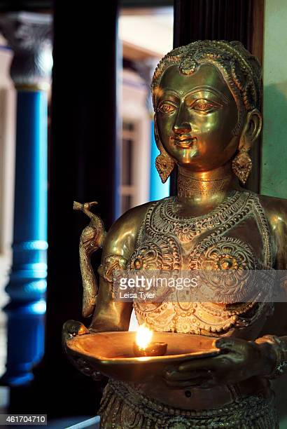 An old statue inside Chettinadu Mansion a hundred plus year old mansion recently converted into a hotel in Kanaduthakan in the Chettinad region of...