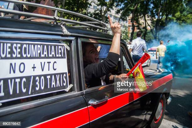 An old taxi during a demonstration against private services such as Uber and Cabify demanding Government to apply transport regulation law