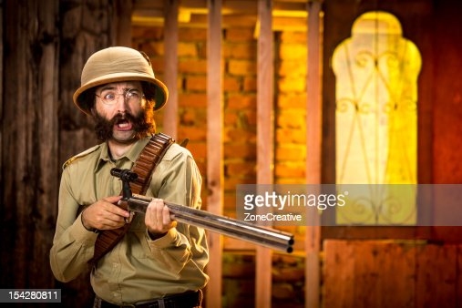 An old time explorer or adventurer with a gun : Stock Photo