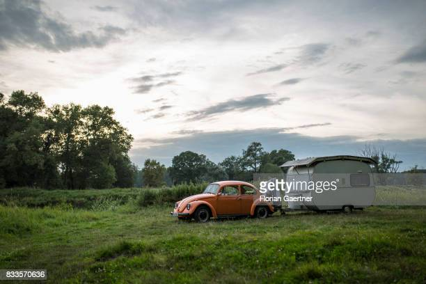 An old VW Kaefer with a caravan stands near the river Elbe on August 15 2017 in Havelberg Germany