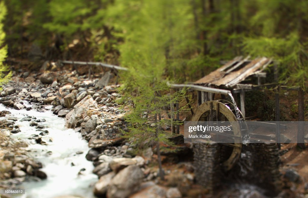 An old water wheel mill is seen on the banks of a small stream on June 2, 2010 in Saas-Fee, Switzerland.