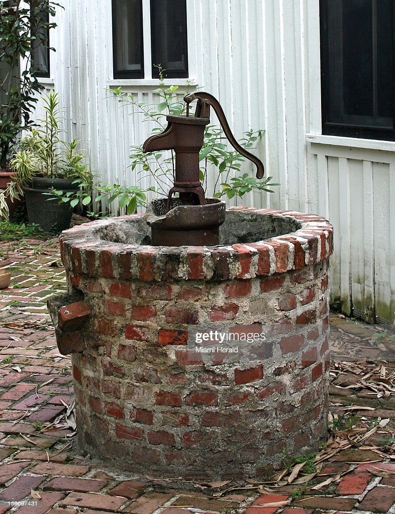 An old well in front of the Nehrling house.