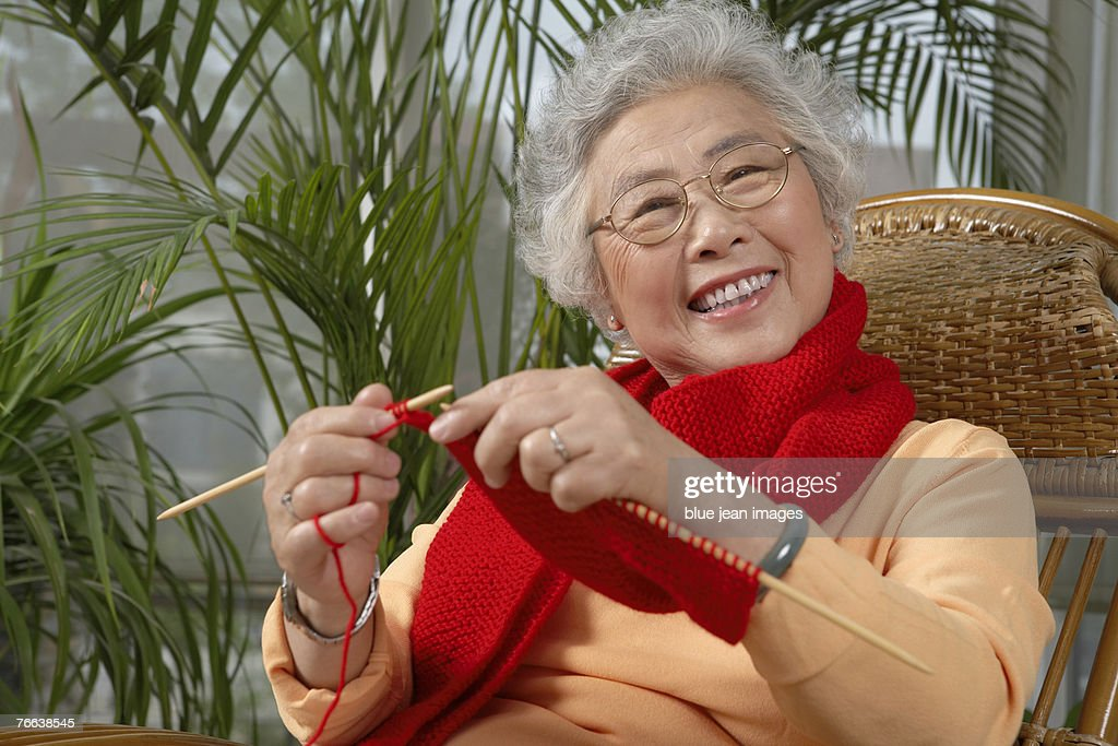 Old Lady Knitting Images : An old woman knitting stock photo getty images
