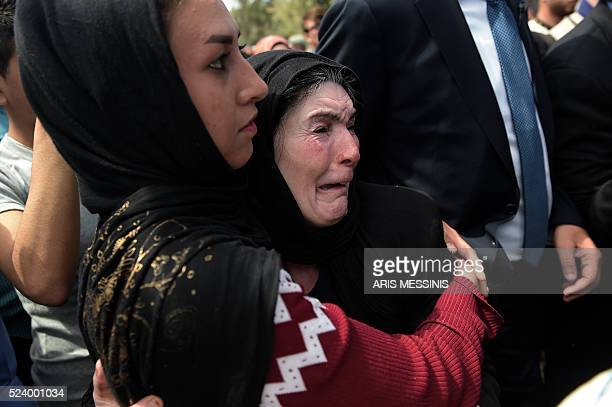 An old woman reacts as Queen Rania of Jordan visits the refugee camp of Kara Tepe in Mytilene on April 25 2016 MESSINIS