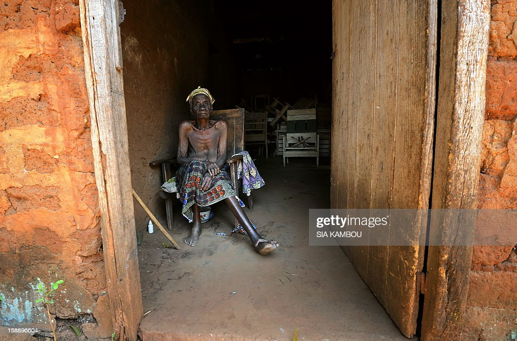 An old woman sits in her house in Damara, the last strategic town between the rebels from the SELEKA coalition and the country's capital Bangui, on January 2, 2013, as the commader of the regional African force FOMAC warned rebels against trying to take the town, saying it would 'amount to a declaration of war.' The rebels, who began their campaign a month ago and have taken several key towns and cities, have accused Central African Republic leader Francois Bozize of failing to honor a 2007 peace deal. AFP PHOTO/ SIA KAMBOU