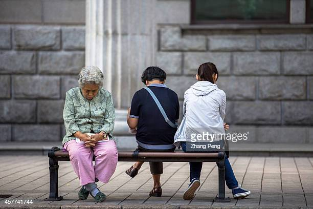 HA'ERBIN HEILONGJIANG CHINA An old woman sits on the street napping In China there are more than 200 million old people of over 60 years old at...