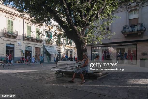 An old woman tries to cool off from the heat in the shadow of a tree on August 03 2017 in Reggio Calabria Italy An intense heatwave is sweeping...