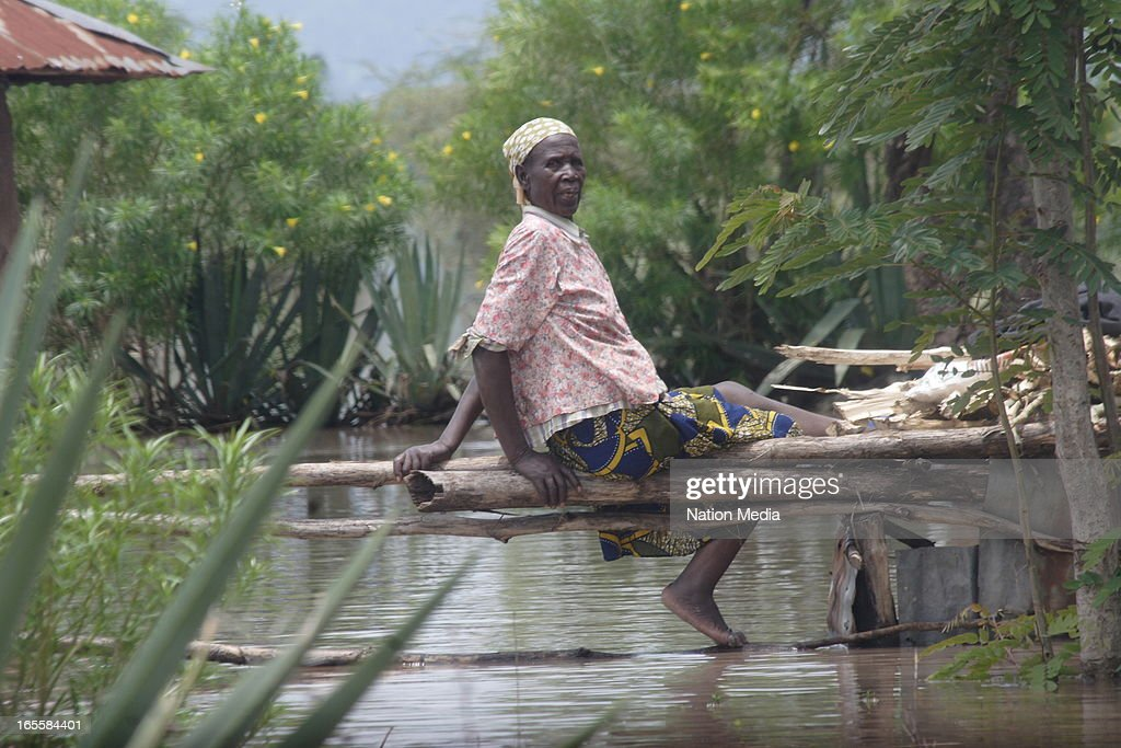 An old woman waits for help after the floods on April 1, 2013 in Kisumu County, Kenya. Thousands of people have been displaced by the heavy rains with houses destroyed and livestock lost. At least 10 people have reportedly been killed by the floods.