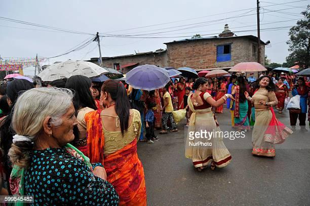 An old woman watch the dance as Hindu devotees lining to offer ritual prayer at the Rishishwor Mahadev Temple during Rishi Panchami Festival...
