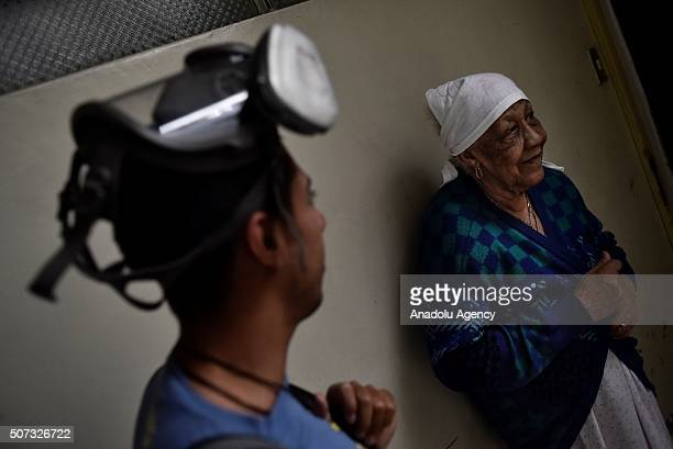 An old woman who has symptoms of virus Zika is seen at her house before health employees fumigates against Aedes Aegypti mosquito on January 28 2016...