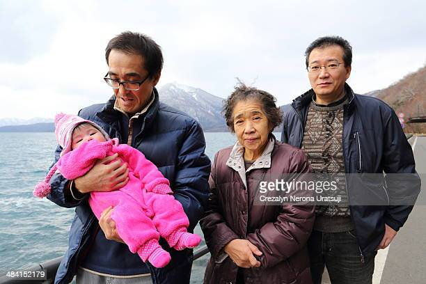 An old woman with her sons Uncle holding her very first niece
