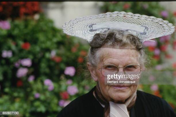 An old women wearing a traditional Breton headress from the town of Lorient in the region of Morbihan Brittany | Location Brittanny France