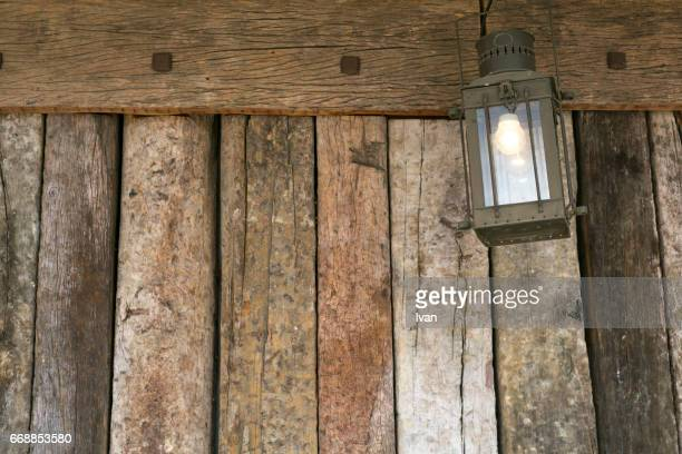 An old Wooden Wall and Ancient Kerosene Lamp