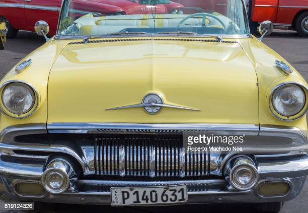 An old yellow car in Havana which is being used as a taxi fro tourists