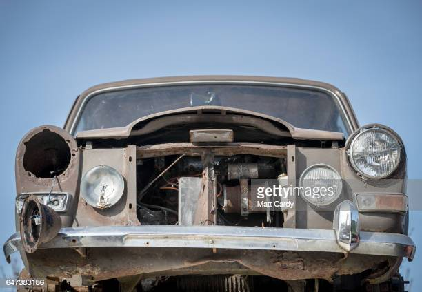 An older classic car waits to be processed at Pylle Motor Spares and Metal Processing a licensed scrap yard in Pylle near Shepton Mallet on March 2...
