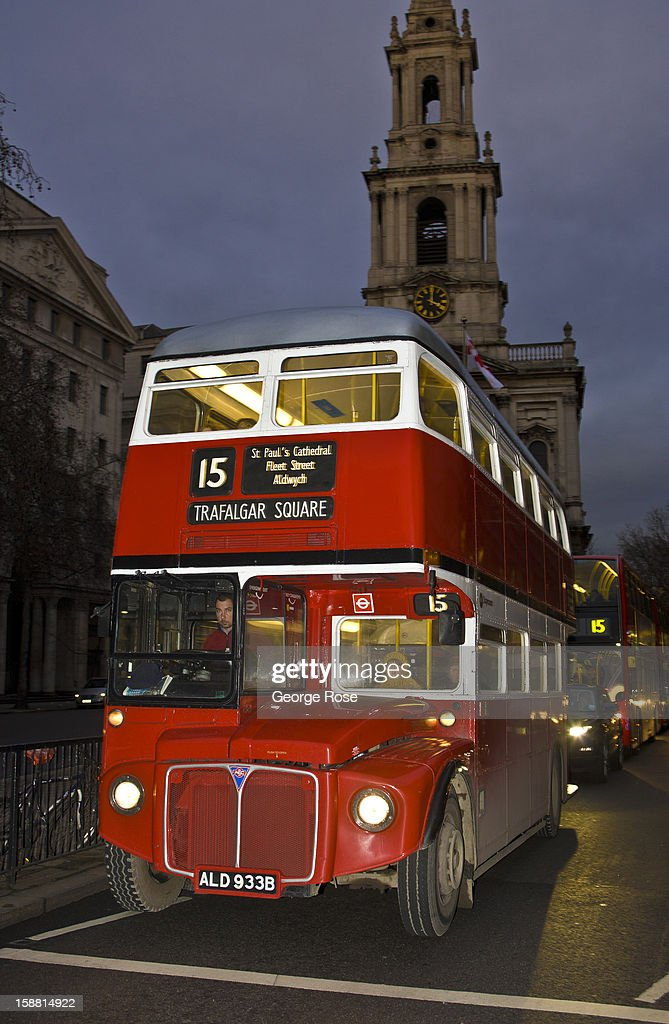 An older style double deck bus moves along The Strand near Covent Garden on December 7, 2012, in London, England. Central London captures the Christmas holiday spirit, with shops, museums, hotels, and other major tourist attractions displaying festive decorations.