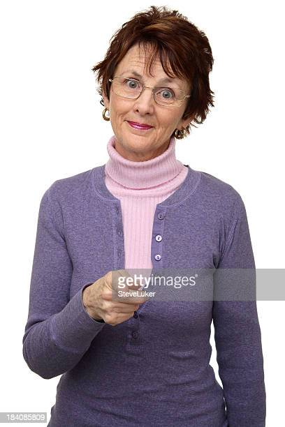 An older woman pointing at the camera
