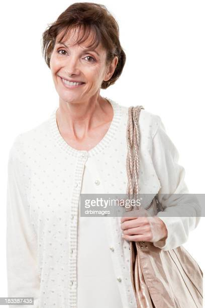 An older woman smiling waist up picture